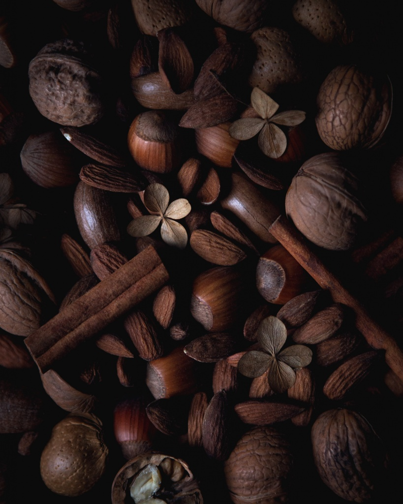 Texture shot of nuts and cinnamon