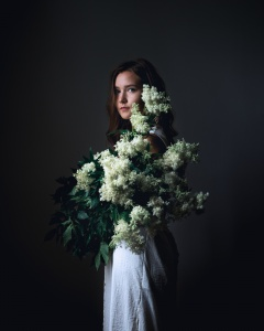 Moody portrait with flowers