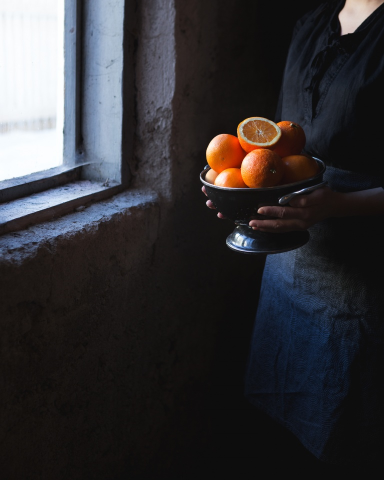 Oranges by window