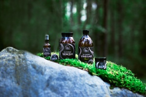 Product family photography in a moody forest