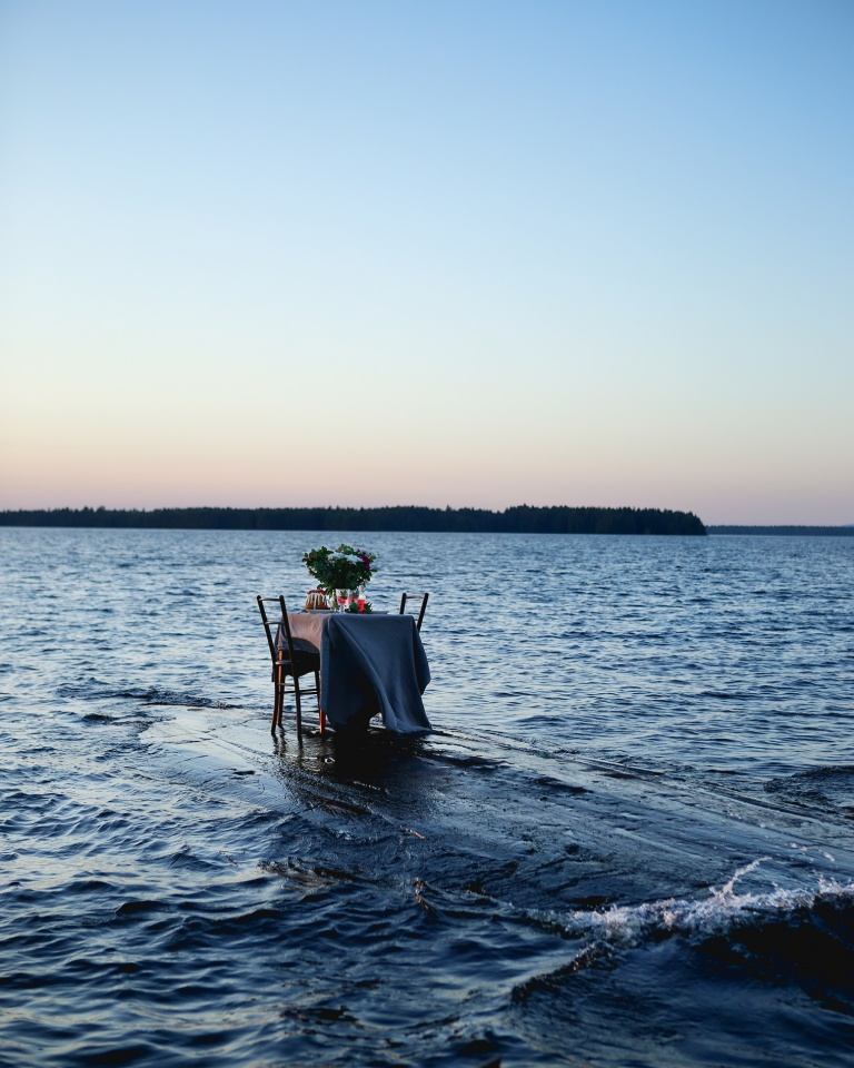 Outdoor table setting by a lake